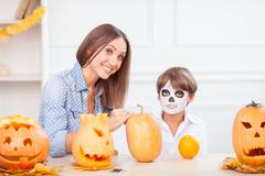Cheerful friendly family is preparing for nut-crack Night Stock Photos