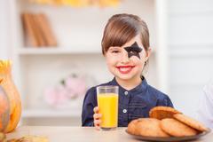 Cute female child is preparing for Nut-Crack Night - stock photo