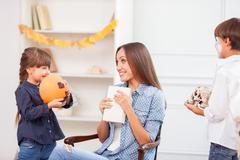 Beautiful friendly family is celebrating Nut-Crack Night - stock photo