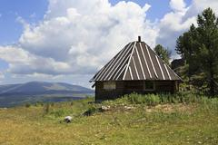 Stock Photo of Wooden house on mountain top Tiyahta