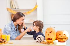 Cute woman and daughter in Nut-Crack Night - stock photo