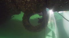 Tire of the car under water spectacular illuminated by sunlight Stock Footage
