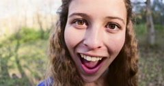 Cute girl making a goofy face, distorted by fish eye lens Stock Footage