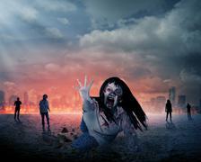 Scary female zombie with burning city background Stock Photos