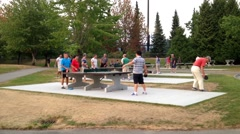 People playing table tennis at park Stock Footage