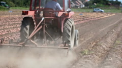 Land cultivation with tractor Stock Footage