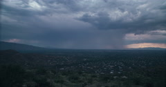 4K Cine 24p monsoon cloud bursts pano over Tucson time lapse Stock Footage