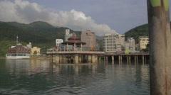 Pan at sun moon lake pagoda Stock Footage