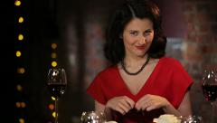 Romantic Brunette in a Red Dress with a Rose, Candles and Wine Smiling, Flirting Stock Footage