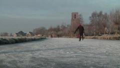 Skating on natural ice by Dutch village Stock Footage