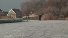Ice skating on natural ice nearby village in Holland. Stock Footage