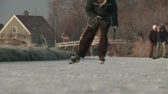 Ice skating on natural ice in sunny landscape. Stock Footage