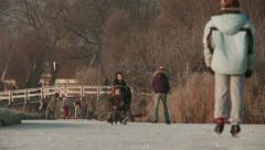 Ice skating an riding sled on natural ice Stock Footage