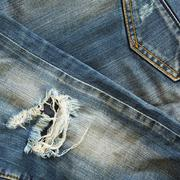Denim blue jeans old torn of fashion design Stock Photos
