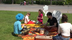 Young people teach children to play with various musical instruments. 4K Stock Footage