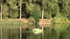 Young couple on a lake on pedaling boat Stock Footage