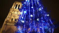 Christmas Tree In Front Of Notre Dame Of Paris Cathedral Stock Footage