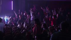 Concert spectators in the light of lights lighting clap and singing - stock footage