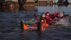 Survival suits in water Stock Footage