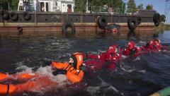 Survival suits training Stock Footage