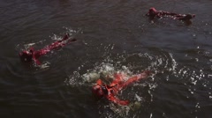 Stock Video Footage of Water Survival suits Training.
