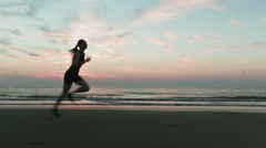 Cross Country Runner on a Beach - stock footage