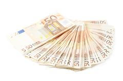Multiple fifty euro bank notes - stock photo