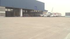 Airplane in airport, hangar, Xiamen, China Stock Footage
