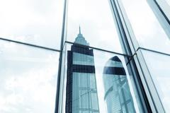 Landmarks reflection on glass walls of skyscrapers Stock Photos