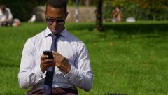 Businessman sending messages or Email with a mobile phone: smartphone Stock Footage