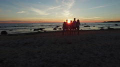 Aerial drone shot of people looking at sunset at the sea coast Arkistovideo