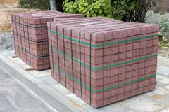 Two stacks of concrete pavement tiles Stock Photos