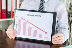 Falling down of economic activity - stock photo