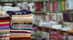 Girl chooses knitwear Stock Footage