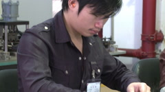 Chinese manufacturing, factory worker Stock Footage