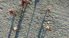 Aerial drone shot of people playing beach volleyball near the sea Stock Footage