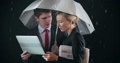 Discussion under Umbrella Stock Footage