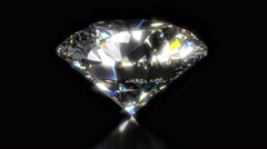 Shining and gleaming diamond on black background  - stock footage