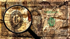 magnifying glass on grunge dollar - stock footage