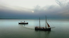 Aerial drone shot of a sailing boat and ferry going in different directions Arkistovideo
