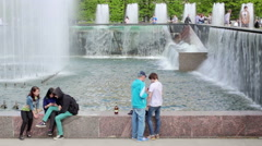 Meeting of young people at the fountain Stock Footage