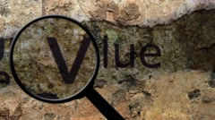 Magnifying glass on value text Stock Footage