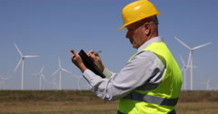 Busy Engineer Man Write Agenda Prospect Plan Block Notes Look Wind Turbines Farm Stock Footage