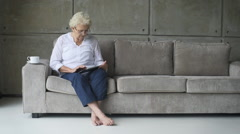 little old granny working with digital tablet - stock footage