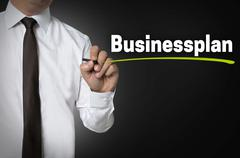 Business Plan is written by businessman background concept - stock photo