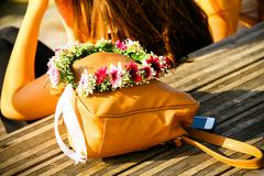 Stock Photo of Orange bag and a wreath of fresh flowers