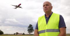 Airport Staff Supervisor Person Looking Traffic Aircraft Landing Plane Lights Stock Footage