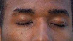 Black man eyes: African-American man opens his eyes  Stock Footage