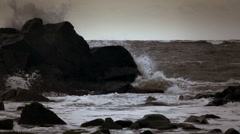 Black rocks, waves splashes at shallow water. Stock Footage