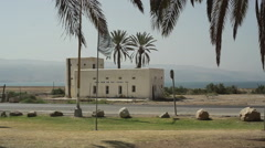 Old building with palms next to the Dead Sea, Israel, Palestine Stock Footage